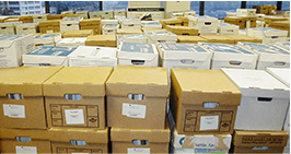 Rows of boxes of shredding documents in an office