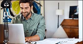 Man booking residential shredding on laptop